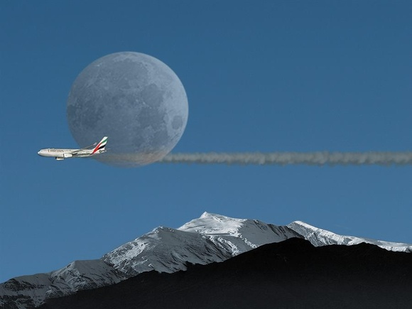 Full moon abeam for this Emirates fligh teasing north american mountains