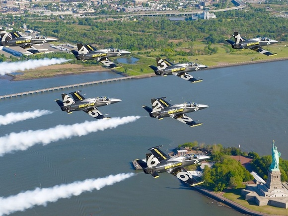 The Breitling Jet Team flies over the Statue of Liberty.