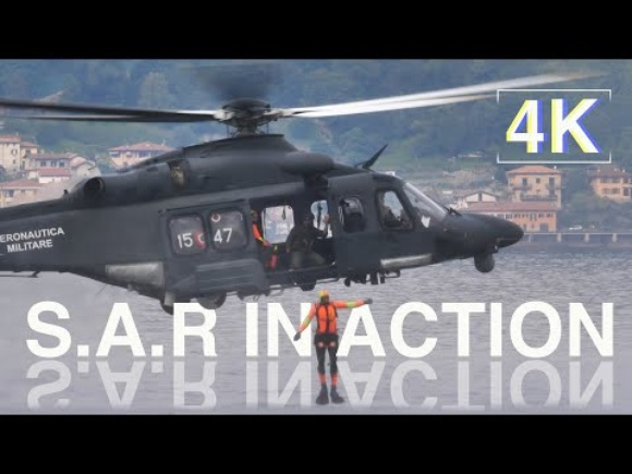 Military Helicopter does a Search and Rescue Display a Lake Water 4K