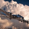 B-17 flying in a cloudy sky at half-moon