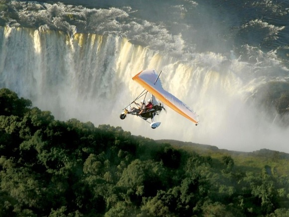Microlight flying above Victoria Falls